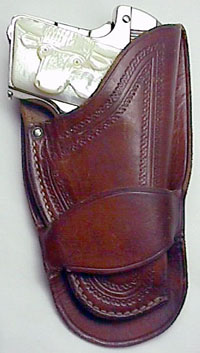 Colt Model N with Carved Steerhead pearl in single loop holster.